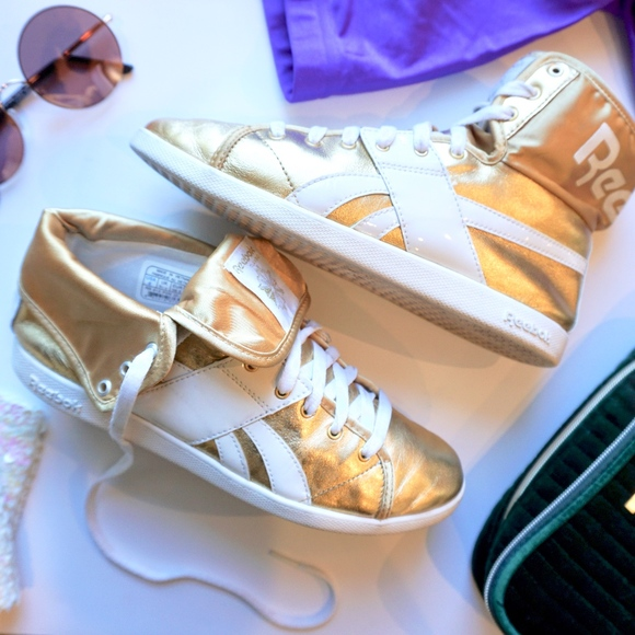 36086d7e7b4 Reebok Women s Top Down Metallic Gold Sneaker